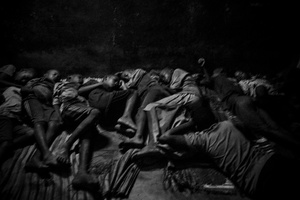 Talibes sleep next to each other inside a daara on the concrete floor without any protection. Saint Louis, Senegal, 21 May 2015.