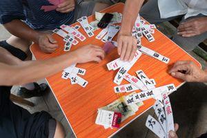 The Zi Pai Game, Xijiang, Guizhou, China.