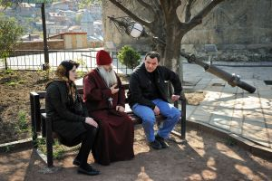 A orthodox priest gives advice to a couple from Tbilisi.