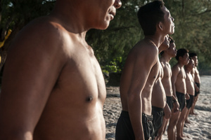 The UXO salvage diver team during training on the island of Koh Rong off the coast of Sihanoukville, Cambodia, line up ahead of a sea swim. All the divers were previously de-miners with the Cambodian Mine Action Centre and were selected by the Golden West Humanitarian Foundation from a group of over forty applicants.