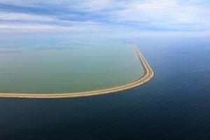 Dike for future polder IJsselmeer, inner sea (Zuyder Sea).