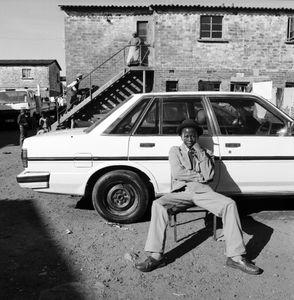 Young Man with his Car. Langa.