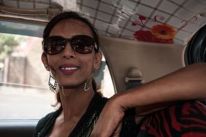 Urmi takes a cab to travel to one of the communities of hijras that she looks after.  © Alison McCauley