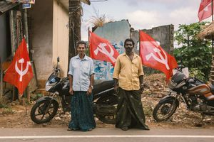 Comrades in front of communist flags