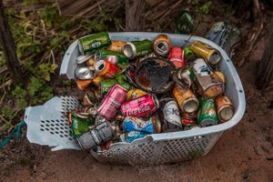 Basket of old soda cans sold to tourists that walked into the Queimada dos Britos. Tourism is reaching the quiet life of the oasis which is well received when visitors walk in. Locals keep a stock of soda drinks that they sell to tourists as a way to make some money that allows them to buy some necessary products like clothes, coffee and rice. © Eduardo Leal/4SEE