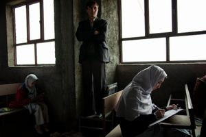 Female Afghan Hazara students sit an exam at the Marefat High School in Dasht-i-Barchi in Kabul, Afghanistan on Thursday, December 14, 2009. The Hazara are a Shiite minority in Afghanistan who have at times been persecuted by Afghanistan's dominant Pashtun ethnic group. © Adam Ferguson
