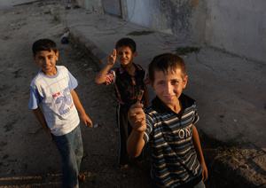 Children in Assas playing with casings and unexploded RPG shells.