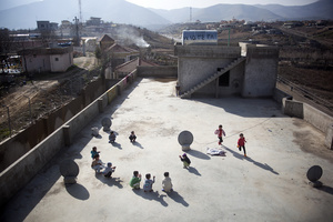 Children play on the rooftop of the unfinished building where they have been living with their families since August 2014, when they escaped from Sinjar. 01/02/15. Sitak, Iraq.