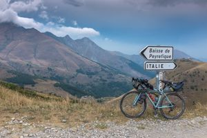 Crossing the French-Italian border on a gravel track over the Col de Tende (Colle di Tenda)
