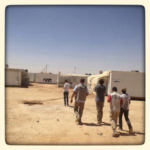 Photographer Michael Christopher Brown walks with teenagers through Za'atari refugee camp.