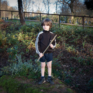 Boy with Stick Gun playing World War III (Russia versus Ukraine)