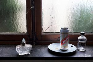 Still life with emty perfume bottle, cara pils on a plate and empty bottle of disinfectant