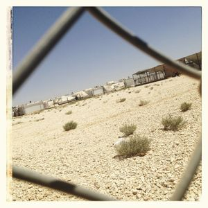 Looking through a fence towards the basketball court at a Save the Children supported multi-activity centre