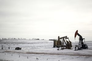 Oil pump jacks are seen along Interstate 94 in the Bakken Formation near Belfield, North Dakota in January 2017.