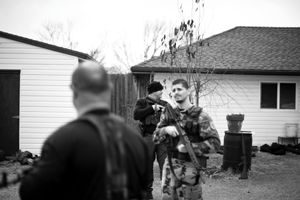 Dallas, Texas, 2011. The Texas Survivalists train in the backyards of their suburban homes. © Spike Johnson