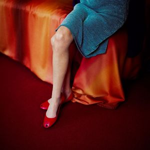 """Red Shoes from the series, """"Still Here."""" Showing at Wapping Project Bankside. Courtesy of PhotoLondon."""
