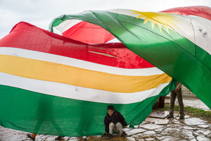 Children playing with kurdish flag