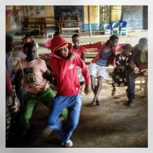 Children dance in a club in Kibera. The Kibera slum is the largest slum in Nairobi with around half a million inhabitants.
