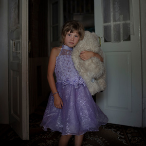 Cristina Gradinari, 6, shares her dreams with her teddy bear. Also, as soon as she's not in the fields, she makes sure to dress herself like a princess.