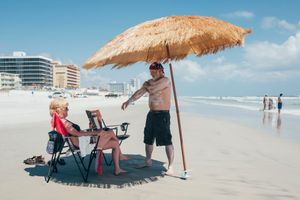 A couple enjoying Ormond Beach. Daytona Shores, Florida.