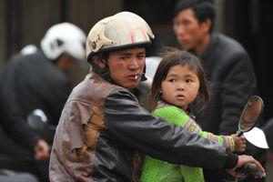 Man with Daughter waiting in Sapa, Vietnam