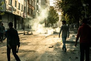 Burning barricades and tear gas used by Turkish riot police during anti-government demonstration in Gazi neighbourhood in Istanbul, Turkey.