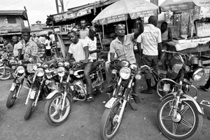 Boys with their motorbikes at the market place.  About three boys dies every month when alcohol and drugs are combined with driving motorbikes.