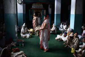 Vrindavan, India, 2009 - Each and every day this Ashram is crowded with widows singing their psalms in honour of Lord Krishna. © Massimiliano Clausi/POSSE Photographers