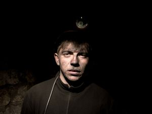 Portrait of a young coal miner just came back from work.