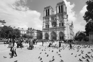 Tourists Enjoying at Notre Dame Gothic Cathedral in Paris,France