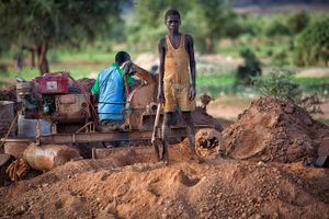 "Nuru (13) has been tasked to work at the pulverizing machine. He says: ""Everything me and my brother earn, we take home to our parents"" © Matjaz Krivic"