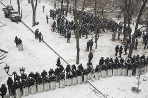 Police protects governmental district in Mariinsky park near stadium, where protesters burned tires. Kyiv, Jan. 21, 2014.