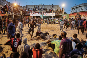 A tournament in the Adrien Senghor arena leans towards the end. The wrestlingfights take place in the late evenings when temperatures drop. Dakar, Sierra Leone, 28 March 2015.