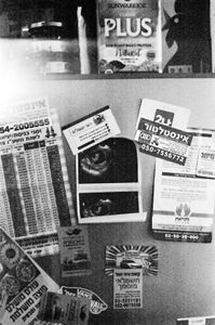 A picture of the first echography, standing on the door of the fridge.