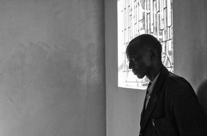 A  young MCF teacher soberly reflects as several of his students recall the 2008 post-election violence and murder in their hometown of Eldoret.                                                                © Lola Reid Allin