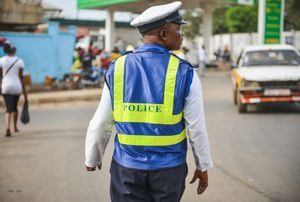 A Sierra Leone Policeman directs traffic on a road above Freetown.