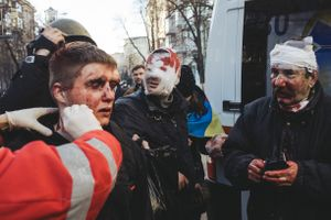 Doctors provide medical assistance to those victims who suffered during a crackdown on Institutska street. Kiev, Feb. 18, 2014
