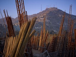 Yards supplying construction materials in the Nawabadi Guzargah district of Kabul, overlooked by American-controlled electronic eavesdropping equipment on the summit of Kohe Asmai. © Simon Norfolk.
