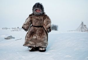 On the Tundra....A Young Nenets boy plays in -40 degrees on Yamal in the winter in Siberia. © Simon Morris, United Kingdom, Shortlist, Smile, Open. Courtesy of 2015 Sony World Photography Awards.