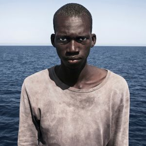 Mediterranean Sea, 1 August 2016. Amadou (16), from Mali, poses for a portrait minutes after being rescued on the Mediterranean Sea, 20 nautical miles off the Libyan coast by a rescue vessel provided by the NGO Jugend Rettet. The rubber boat in which he travelled carried 118 people on board, who were transferred by the Italian Coast Guard to Lampedusa (Italy).