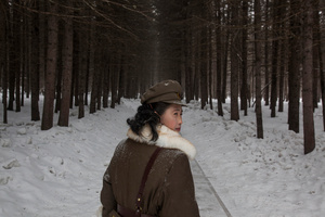 A soldier, working as a guide, walks through a forest that is said to be a former camp site of the late North Korean leader Kim Il Sung; Mount Paektu, NorthKorea, 04 April 2012.