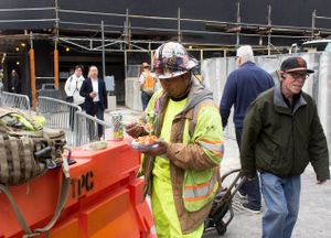 Urbane Construction Worker Eating Lunch