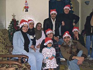 A mobile phone photograph of exiled Iraqi civilians: a Muslim family celebrates Christmas at home. Image collected by Geert Van Kesteren. © bpb