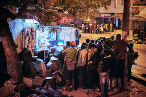 A group of people watch the wrestling match on television in Dakar, Senegal, 04 April 2015.
