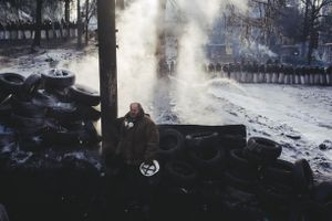 A man stands near barricade on Hryshevskoho street early in the morning. Kyiv, Jan. 27, 2014.