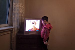Absorbed by Spider Man. Kabul, Afghanistan 2012 © Sandra Calligaro