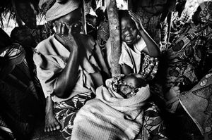 The funeral of Henry Konerala, ten-months-old, who died from diarrhoea and vomiting a few days after arriving in the Gety camp. He was one of eighteen people who died that day, just before Congo's historic elections. 2006.