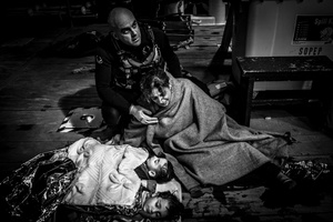Syrian mother with her two drowned children onboard a rescue ship in the Aegean