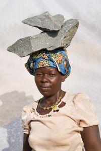Abur Janet: Earns 1,000 shillings ($0.32) per Jerrycan of gravel.
