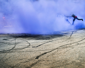 Motorcycle Stuntman with Blue Smoke
